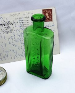 Antique green 2 oz poison bottle embossed Frank A. Rogers 1 Beaumont St W1, rectangular ribbed green chemist bottle