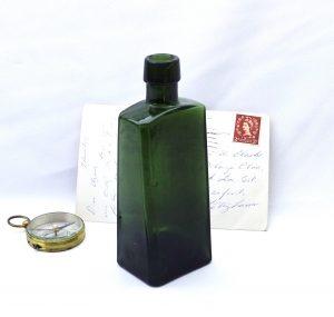 Antique wedge shaped olive green bottle, scarce antique bottle unusual shape