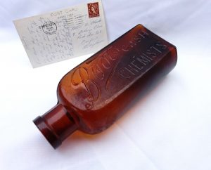 Antique large amber Boots Cash Chemist bottle, Edwardian medicine bottle, circa 1905, 22cm