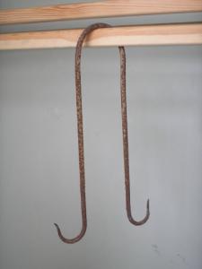 Antique iron butcher's double meat hook.