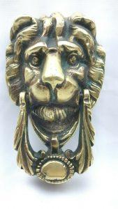 Antique brass lion head door knocker with integral strike plate and new bolts. Large Victorian lion door knocker. Period door furniture