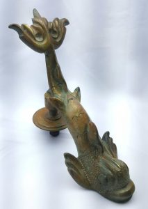 Vintage dolphin door knocker by F. Abela & Sons in the form of a stylised dolphin / sea creature. Period door furniture with strike plate