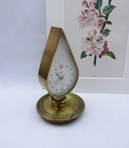Vintage Swiza alarm clock in flame shape, brass chamberstick, candle holder shape, Swiss 7 jewels