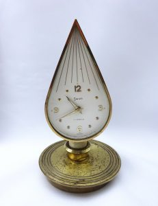 Vintage Swiza alarm clock in flame shape, brass chamberstick, candle holder shape, Swiss 7 jewels