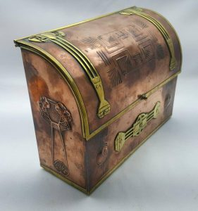 Arts & Crafts copper box in the manner of Archibald Knox for Liberty, a stationery box with Art Nouveau detail and applied brass features