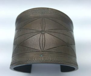 Large African bronze manilla, unusual slave money currency, bangle or wrist torc with symmetrical and geometric designs in lozenge shape