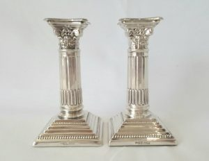 Antique Corinthian candlesticks, a small silver plated pair by Francis Howard of Sheffield.