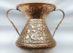 Antique copper Middle Eastern vessel with twin handles and foliate decoration, ideal water pot or vase with stylised petal base.