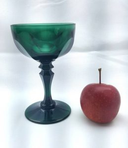 Victorian green champagne drinking glass, antique 19th century glass with shallow cup bowl, fluted stem and cut panel bowl, wine glass