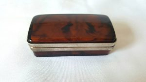 Small vintage faux tortoiseshell box with sprung hinged lid, diminutive celluloid trinket box or pill box from mid 20th Century