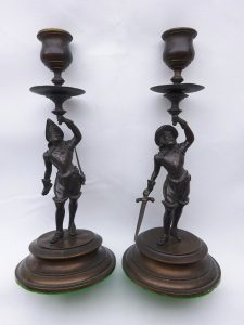 Bronze candlesticks, a 19th Century pair of antique candlesticks in the manner of 16th Century Spanish conquistadors, with period costume