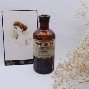 Antique amber poison bottle, ribbed, original label Phenol Liq BP, Boots Pure Drug Company, UGB United Glass Bottle