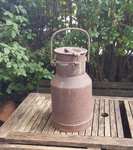 Vintage milk churn pail with lockable lid in rusty rustic condition, medium size dairy churn left in 'barn-find' type condition