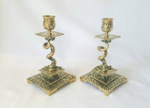 Vintage brass candlesticks with stylised fish body spiral columns, a pair of Rococo candle sticks with Gothic design influence