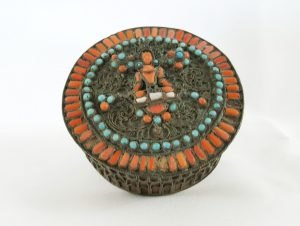 Tibetan brass and filigree lidded pot with turquoise & red coral bead decoration, Buddha deity central feature, antique caddy or box
