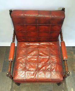 Mahogany and leather campaign style chair with faux bamboo turned legs & arms and brass brackets.