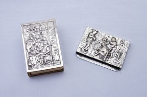 Antique Dutch silver metal matchbox holder & silver plated matchstick holder featuring repoussé scenes men smoking. Collectable tobacciana