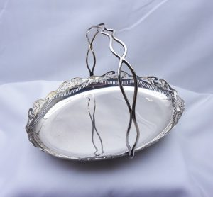 Antique silver plated fruit basket. Oval swing handled pierced silver plate basket, bun feet, cake stand bonbon dish, bread basket, nut bowl