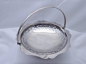 Antique silver plated fruit basket. Swing handled pierced silver plate basket with three feet, bonbon dish, bread basket, nut bowl