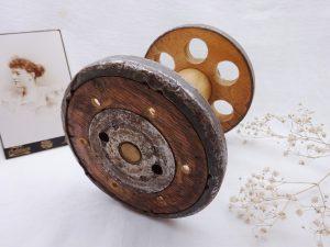 Large industrial woolen mill spool repurposed as an egg holder.