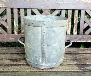 antique half bushel grain measure pot with rustic patina, unusually made entirely in steel