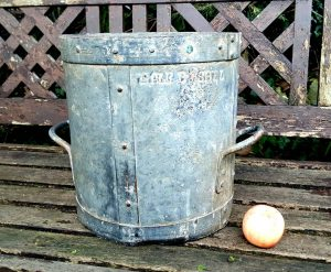 antique half bushel grain measure pot with rustic patina, unusually made entirely in steel