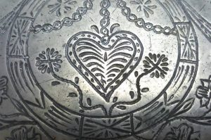 "Antique pewter charger, a large 18th Century Dutch pewter charger of 15"" diameter, with engraved marriage initials of R&E plus touch mark"