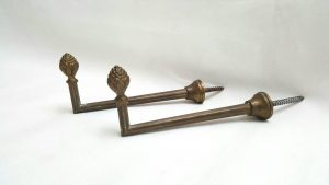 Pair of antique French ormolu gilt brass tie-back hooks with pineapple finials