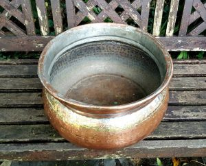 Oval copper jardiniere, an antique Middle Eastern hammered copper oval planter of unusually large size, also suitable as log / kindling bin