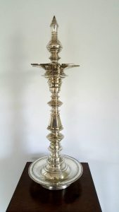 Indian temple oil lamp, a fabulous large antique silver plate Kerala Nilavilakku, from Southern India, used in ritual worship ceremonies.
