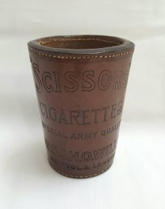 Antique brown tooled leather dice shaker - an advertising piece produced for Wills Scissors cigarettes