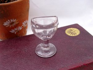 Antique eye bath, faceted clear glass eye bath, British Made 2 on base, pale pink tint to glass