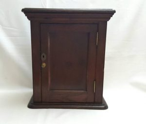 Late Victorian oak wall hanging or freestanding cupboard with single panel door and internal shelves.