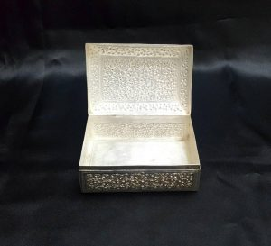 Indian silver rectangular lidded box with extensive and elaborate repousse foliate decoration, a betel nut, trinket pot or multipurpose box