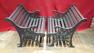 Two garden seats, a fully refinished pair of cast iron garden seats with new slats and finished in Farrow & Ball eggshell Railings paint.