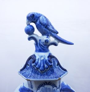 Rare 18th Century Dutch Delft covered vase of octagonal baluster form signed Johannnes Van Duyn, parrot finial to lid, blue oriental flowers