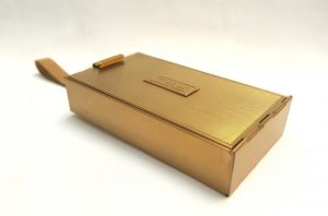 Art Deco vanity & cigarette case - a gilt finished 'Park Lane' all-in-one compendium compact minaudiere by L.S Mayer