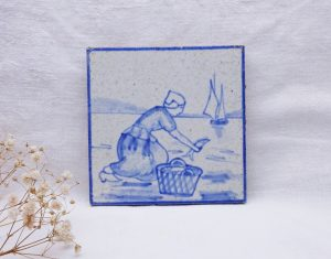 Victorian English Delft tile by T & R Boote, boat, fisherwoman, blue and white faience tile. Hand painted Delftware granite earthenware tile