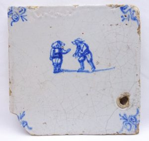 18th Century Delft tiles, blue and white faience tiles, hand painted shepherdess, figures, cherub with flag