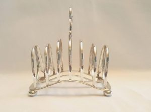 Sterling silver toast rack, by Atkin Brothers, assayed at the Sheffield Office & dated 1913, heavy 157g