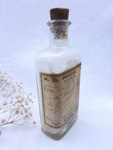 Antique veterinary medicine bottle with original label and contents. R. H. Penhale, Holsworthy, Astringent Bismuth, tablespoon measurements