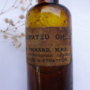 Antique chemist bottle with original label - Camphorated Oil, William Pickard, Bell Vue Bude & Stratton
