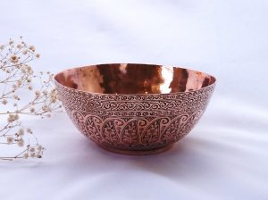 Antique copper bowl from Middle East, floral paisley pattern, makers mark on base. Hammered and engraved copper dish, nut bowl or fruit bowl, Persian