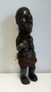 Vintage African figure, a carved wood fertility figure, female Congo Tribal Power Figure Democratic Republic of the Congo, formerly Zaire.