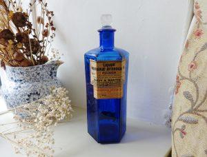 Vintage large 20 oz cobalt hexagonal pharmacy poison bottle with original labels and a glass stopper, chemist bottle, ribbed medicine bottle