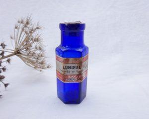 Antique Not To Be Taken poison bottle with original chemist label for Luminal, Wright Layman Umney Ltd, Southwark London, pharmacy bottle