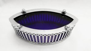 An unusually shaped antique late 19th Century silver and cobalt glass liner bonbon dish.