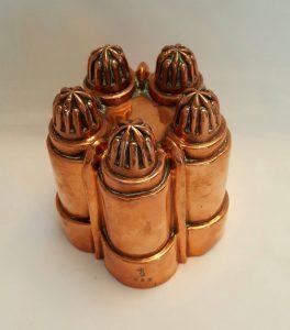 Antique copper jelly mould - a late 19th Century Victorian copper jello mold by Benham & Froud design No. 453, five turrets