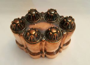 Antique copper jelly mould - a late 19th Century Victorian copper jello mold by Benham & Froud with six turrets and orb and cross logo