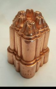 Antique copper jelly mould - a late 19th Century Victorian copper jello mold by Benham & Froud, design No. 616 with six turrets